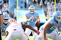 CHAPEL HILL, NC - SEPTEMBER 28: Sam Howell #7 of the University of North Carolina takes the snap during a game between Clemson University and University of North Carolina at Kenan Memorial Stadium on September 28, 2019 in Chapel Hill, North Carolina.
