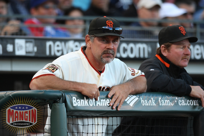 SAN FRANCISCO - JULY 3:  Manager Bruce Bochy of the San Francisco Giants watches from the dugout during the game against the Chicago Cubs at AT&T Park in San Francisco, California on July 3, 2008.  The Giants defeated the Cubs 8-3.  Photo by Brad Mangin