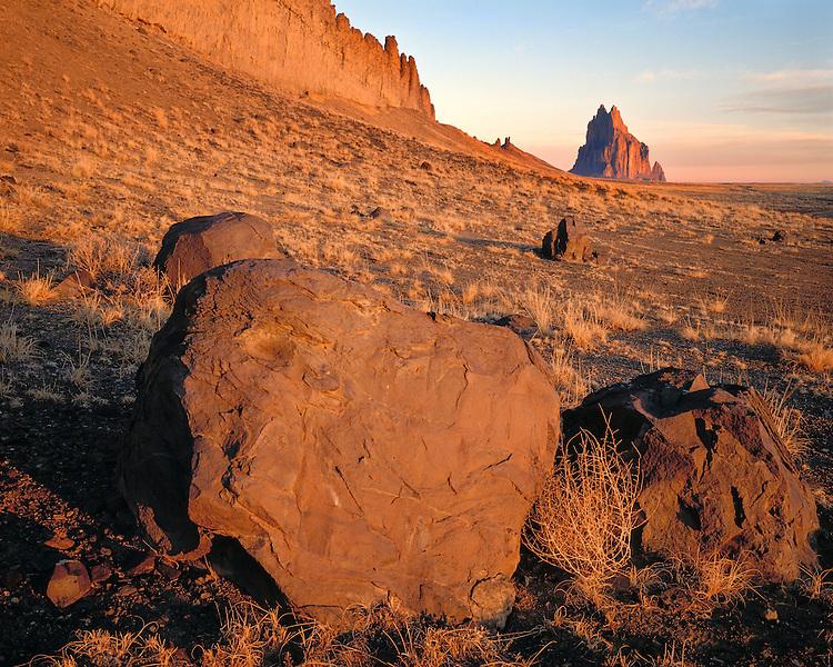 Sunrise light on a boulder field below Shiprock; Navajo Nation, NM