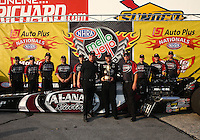 Oct 6, 2013; Mohnton, PA, USA; NHRA top fuel dragster driver Shawn Langdon celebrates with crew after winning the Auto Plus Nationals at Maple Grove Raceway. Mandatory Credit: Mark J. Rebilas-