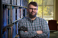 """Spring 2019 Commencment Alumni Speaker Peter Kudenov. Peter Kudenov finished his MA in English in December 2013. His thesis was titled, """"Rhetorical Player Engagement in Fallout: New Vegas."""" In his thesis, he attempted to describe a model for analyzing rhetorical participation between plays and player characters in videogames and used Fallout to demonstrate what successful rhetorical interactions looked like. Currently Peter is a PhD student in the Communications, Rhetoric, and Digital Media program at North Carolina State University. His day-to-day work includes a variety of teacher and research assistantships."""