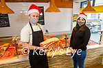 Paddy McMahon displaying some of their meat produce to Wioleta Kelly at McMahon Butchers in Abbeyfeale