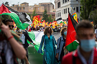 Rome, Italy. 22nd May 2021. Today, the Trade Union USB, Potere Al Popolo Party, Rifondazione Comunista Party, Palestinian Community of Rome (Comunità Palestinese di Roma e Lazio) and other organizations of the non-parliamentarian Left held a march from Piazza della Repubblica to Piazza San Giovanni:<br /> - to protest against the Global Health G20 summit held in Rome; <br /> - to protest against the alleged capitalist/neo-liberalist management of the pandemic Covid-19/Coronavirus vaccines; <br /> - to protest against alleged multinationals' speculations and their various interests in the pharmaceutical industry;<br /> - To scrap Vaccines' patents (brevetti); <br /> - to call for an Universal Basic Income, proper policies protecting workers and their jobs, and do not let multinationals to cut jobs and factories;<br /> - in Support and Solidarity with Palestine. In 15 days of Israeli bombings, the Gaza Strip alone has suffered the death of at least 248 people - including 66 children -, 1,900+ wounded, and 72,000+ people displaced.<br /> Moreover, protesters called for free vaccines for the whole world population and that every State could have the opportunity to produce them autonomously throughout the nationalization of the pharmaceutical factories.