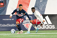 FOXBOROUGH, MA - OCTOBER 16: Damian Rivera #72 of New England Revolution II turns to avoid Edwin Munjoma #26 of North Texas SC near the North Texas goal line during a game between North Texas SC and New England Revolution II at Gillette Stadium on October 16, 2020 in Foxborough, Massachusetts.