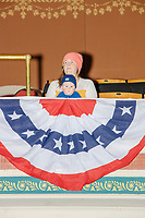 """Julia Jefka holds son Isaac Jefka (6 months) before a rally for Democratic presidential candidate and Massachusetts senator Elizabeth Warren at Rochester Opera House in Rochester, New Hampshire, on Mon., Feb. 10, 2020. This is the final day of campaigning before voting in the primary happens on Feb. 11. Warren has fallen to 4th or 5th place in recent polls. Julia Jefka said she was undecided but likely voting for Sanders or Warren. """"I'm a Vermonter born and raised, so it's tough,"""" she said. Her grandmother served with Bernie Sanders in the Vermont state legislature, she said."""