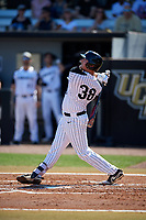 UCF Knights first baseman Dallas Beaver (38) follows through on a swing during a game against the Siena Saints on February 17, 2019 at John Euliano Park in Orlando, Florida.  UCF defeated Siena 7-1.  (Mike Janes/Four Seam Images)