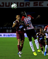 BARRANQUILLA - COLOMBIA, 22-11-2020: German Mera de Atletico Junior y Anderson Plata de Deportes Tolima disputan el balon, durante partido entre Atletico Junior y Deportes Tolima, de los Cuartos de Final Ida por la Liga BetPlay DIMAYOR 2020 jugado en el estadio Metropolitano Roberto Melendez de la ciudad de Barranquilla. / German Mera of Atletico Junior and Anderson Plata of Deportes Tolima battle for the ball, during a match between Atletico Junior and Deportes Tolima of the Quarterfinal First Leg for BetPlay DIMAYOR League 2020 played at the Metropolitano Roberto Melendez Stadium in Barranquilla city. / Photo: VizzorImage / Jesus Rico / Cont.