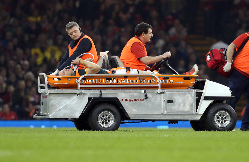 Pictured: Injured Jean de Villiers of South Africa is transferred away after dislocating his knee Saturday 29 November 2014<br /> Re: Dove Men Series 2014 rugby, Wales v South Africa at the Millennium Stadium, Cardiff, south Wales, UK.