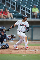 Ramon Torres (2) of the Birmingham Barons follows through on his swing against the Pensacola Blue Wahoos at Regions Field on July 7, 2019 in Birmingham, Alabama. The Barons defeated the Blue Wahoos 6-5 in 10 innings. (Brian Westerholt/Four Seam Images)