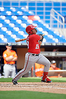 Washington Nationals Onix Vega (19) follows through on a swing during a Florida Instructional League game against the Miami Marlins on September 26, 2018 at the Marlins Park in Miami, Florida.  (Mike Janes/Four Seam Images)