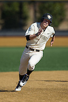 Jonathan Pryor (11) of the Wake Forest Demon Deacons hustles towards third base against the Richmond Spiders at David F. Couch Ballpark on March 6, 2016 in Winston-Salem, North Carolina.  The Demon Deacons defeated the Spiders 17-4.  (Brian Westerholt/Four Seam Images)