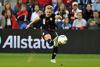 USWNT midfielder Amy Rodriguez (8) shoots on goal.