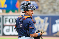 Bowling Green Hot Rods catcher Alexander Alvarez (4) warms up in the outfield prior to a Midwest League game against the Wisconsin Timber Rattlers on July 22, 2018 at Fox Cities Stadium in Appleton, Wisconsin. Bowling Green defeated Wisconsin 10-5. (Brad Krause/Four Seam Images)