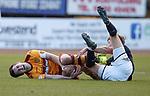Carl McHugh tackles Mark O'Hara and takes both a sore one and a booking
