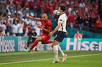 7th July 2021, Wembley Stadium, London, England; 2020 European Football Championships (delayed) semi-final, England versus Denmark;  Martin BRAITHWAITE DEN challenged by Harry MAGUIRE ENG