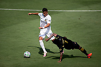 LOS ANGELES, CA - AUGUST 22: Joe Corona #15  of the Los Angeles Galaxy moves with the ball past Latif Blessing #7 of LAFC during a game between Los Angeles Galaxy and Los Angeles FC at Banc of California Stadium on August 22, 2020 in Los Angeles, California.