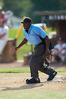 Home plate umpire Marcus Neal indicates a fair ball down the left field line during the game between the Statesville Owls and the High Point-Thomasville HiToms at Finch Field on July 19, 2020 in Thomasville, NC. The HiToms defeated the Owls 21-0. (Brian Westerholt/Four Seam Images)