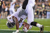January 01, 2014:<br /> <br /> UCF Knights running back Storm Johnson #8 lands in the end zone for a touchdown during Tostitos Fiesta Bowl at University of Phoenix Stadium in Scottsdale, AZ. UCF defeat Baylor 52-42 to claim it's first ever BCS Bowl trophy.