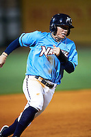NW Arkansas Naturals designated hitter Ethan Chapman (23) running the bases during a game against the San Antonio Missions on May 30, 2015 at Arvest Ballpark in Springdale, Arkansas.  San Antonio defeated NW Arkansas 5-2.  (Mike Janes/Four Seam Images)