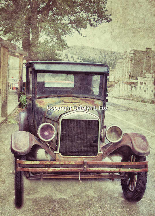 An old truck sits in a small town in Montana.