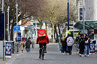 Pictured: A JustEat delivery cyclist in Oxford Street. Friday 19 March 2021<br /> Re: City centre of Swansea, Wales, UK.
