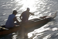 Outrigger canoe paddling near Haleiwa, North Shore of Oahu