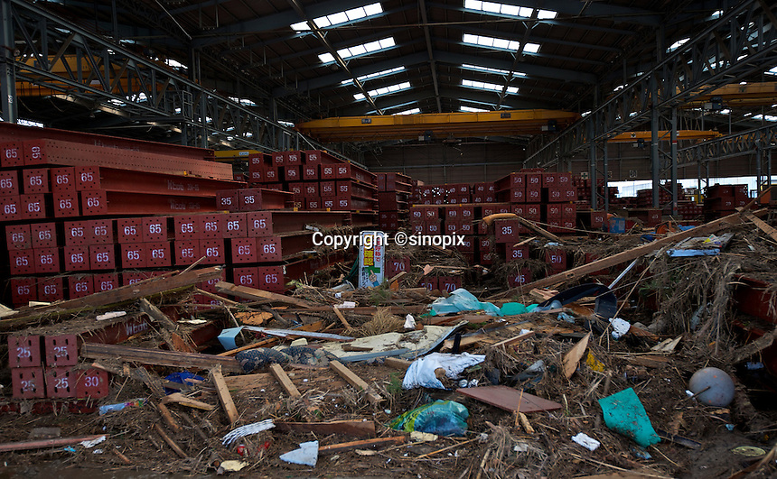 A factory close to Sendai airport that is full of mud and rubbish after the earthquake and tsunami that swept through the area, Sendai, Japan.  The earthquak,tsunami and nuclear fallout has meant that the March 11th quake was the costliest natural disaster known to man..13 Mar 2011.