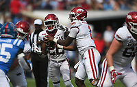 Arkansas quarterback KJ Jefferson (1) hands the ball off to running back Trelon Smith (22), Saturday, October 9, 2021 during the third quarter of a football game at Vaught Hemingway Stadium in Oxford, Miss. Check out nwaonline.com/211010Daily/ for today's photo gallery. <br /> (NWA Democrat-Gazette/Charlie Kaijo)