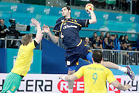 Spain's Angel Montoro Cabello (c) and Australia's Tommy Fletcher (l) and Martin Najdovski during 23rd Men's Handball World Championship preliminary round match.January 15,2013. (ALTERPHOTOS/Acero) /NortePhoto