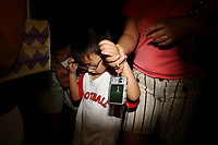 CHINA. Beijing. A child being led by his mother on Tiananmen Square during the Beijing 2008 Summer Olympics. 2008
