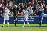 Referee Lee Mason awards a goal to Everton after checking with goal line technology during the Premier League match between Swansea City and Everton at The Liberty Stadium, Swansea, Wales, UK. Saturday 14 April 2018