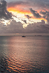 A lone yacht at sunset anchored in the lagoon in Funafuti, Tuvalu