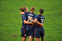 Lauren Cheney (L) and Shannon Boxx (R) congratulate Abby Wambach (Center) on her goal.  The USA captured the 2010 Algarve Cup title by defeating Germany 3-2, at Estadio Algarve on March 3, 2010.