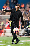 Coach Diego Simeone of Atletico de Madrid kicks the ball during their La Liga match between Atletico de Madrid and Granada CF at the Vicente Calderon Stadium on 15 October 2016 in Madrid, Spain. Photo by Diego Gonzalez Souto / Power Sport Images