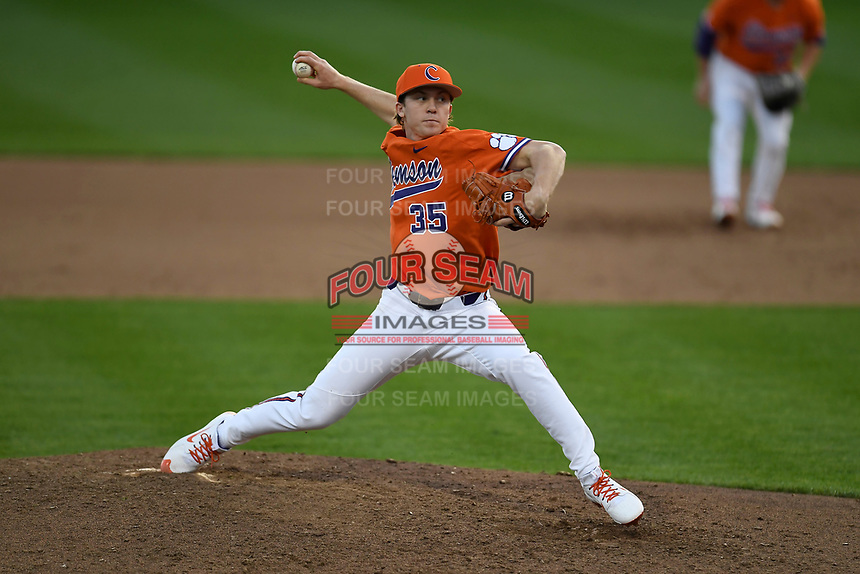 Relief pitcher Ryan Miller (35) of the Clemson Tigers delivers a pitch in a game against the William and Mary Tribe on February 16, 2018, at Doug Kingsmore Stadium in Clemson, South Carolina. Clemson won, 5-4 in 10 innings. (Tom Priddy/Four Seam Images)