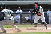 West Michigan Michigan Whitecaps catcher Drew Longley (14) chases down Fort Wayne TinCaps baserunner Rod Boykin (3) during the Midwest League baseball game on April 26, 2017 at Fifth Third Ballpark in Comstock Park, Michigan. West Michigan defeated Fort Wayne 8-2. (Andrew Woolley/Four Seam Images)