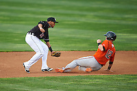 wErie SeaWolves shortstop Gustavo Nunez (12) looks to tag Chance Sisco (12) sliding in during a game against the Bowie Baysox on May 12, 2016 at Jerry Uht Park in Erie, Pennsylvania.  Bowie defeated Erie 6-5.  (Mike Janes/Four Seam Images)