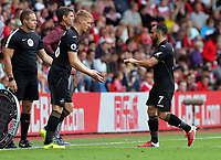 Leon Britton of Swansea City (R) is substituted by team mate Jay Fulton during the Premier League match between Southampton and Swansea City at the St Mary's Stadium, Southampton, England, UK. Saturday 12 August 2017