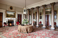 George Stubbs paintings hang alongside 17th century portraits in the entrance hall