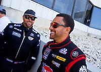 Jun 7, 2015; Englishtown, NJ, USA; NHRA top fuel driver J.R. Todd (right) with Shawn Langdon during the Summernationals at Old Bridge Township Raceway Park. Mandatory Credit: Mark J. Rebilas-