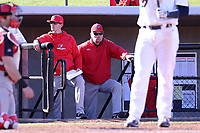 GREENSBORO, NC - FEBRUARY 25: Head coach Bill Currier and pitching coach Jordan Tabakman of Fairfield University watch from the dugout during a game between Fairfield and UNC Greensboro at UNCG Baseball Stadium on February 25, 2020 in Greensboro, North Carolina.