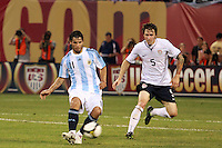 Argentina forward Sergio Aguero (11) and United States defender Dan Califf (5). The men's national teams of the United States and Argentina played to a 0-0 tie during an international friendly at Giants Stadium in East Rutherford, NJ, on June 8, 2008.