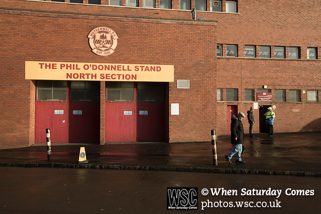 Motherwell 3 Dundee 1, 12/12/2015. Fir Park, Scottish Premiership. A spectator waiting outside the Phil O'Donnell Stand at Fir Park, home to Motherwell Football Club, before they played Dundee in a Scottish Premiership fixture. Formed in 1886, the  home side has played at Fir Park since 1895. Motherwell won the match by three goals to one, watched by a crowd of 3512 spectators. Photo by Colin McPherson.