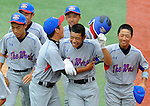 Japan's Takashi Nakayama is congratulated after a home run during the World Championship game during the Cal Ripken Babe Ruth World Series in Aberdeen, Maryland on August 19, 2012. Japan defeated the team from Boyds(MD) representing the United States 17-7 to win the World Championship on Sunday.