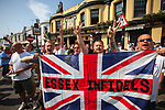 © Joel Goodman - 07973 332324 . 24/04/2011 . Brighton , UK . MFE supporters with an Essex Infidels flag gather at the Railway Bell pub . Nationalist street movement March for England holds a march and rally in Brighton , opposed by antifascists . Photo credit : Joel Goodman