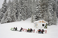 Snowboarders sit on benches near the bunny hill at Showdown Ski Area on King's Hill in the Little Belt Mountains near Neihart, Montana, USA.
