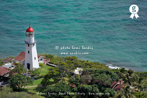 Lighthouse in garden on Pacific Ocean (Licence this image exclusively with Getty: http://www.gettyimages.com/detail/94433102 )