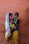 Anita Gope with her son Amit, 9, in Rondih village. Amit cannot speak but can express that he is hungry or needs to be cleaned. He cannot walk or even sit. He lies in bed most of the time.