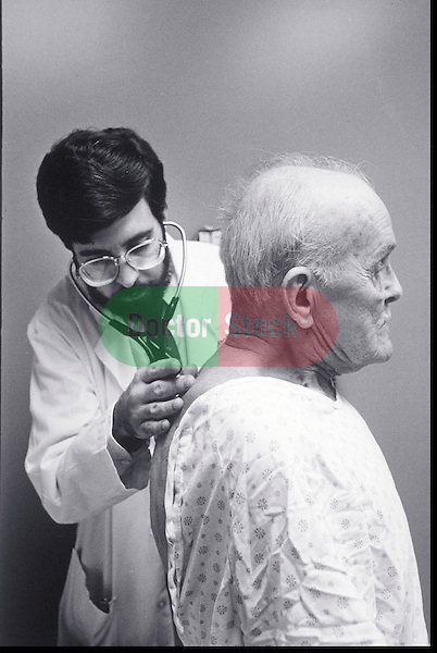 doctor examining elder man