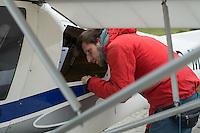 Das SAR Flugzeug der zivilen Seenotrettungsorganisation Sea-Watch auf dem Fluplatz in Kamenz.<br /> Im Bild: Der Sea-Watch-Pilot Ruben Neugebauer bei der Vorflugkontrolle.<br /> 17.5.2016, Kamenz/Sachsen<br /> Copyright: Christian-Ditsch.de<br /> [Inhaltsveraendernde Manipulation des Fotos nur nach ausdruecklicher Genehmigung des Fotografen. Vereinbarungen ueber Abtretung von Persoenlichkeitsrechten/Model Release der abgebildeten Person/Personen liegen nicht vor. NO MODEL RELEASE! Nur fuer Redaktionelle Zwecke. Don't publish without copyright Christian-Ditsch.de, Veroeffentlichung nur mit Fotografennennung, sowie gegen Honorar, MwSt. und Beleg. Konto: I N G - D i B a, IBAN DE58500105175400192269, BIC INGDDEFFXXX, Kontakt: post@christian-ditsch.de<br /> Bei der Bearbeitung der Dateiinformationen darf die Urheberkennzeichnung in den EXIF- und  IPTC-Daten nicht entfernt werden, diese sind in digitalen Medien nach §95c UrhG rechtlich geschuetzt. Der Urhebervermerk wird gemaess §13 UrhG verlangt.]